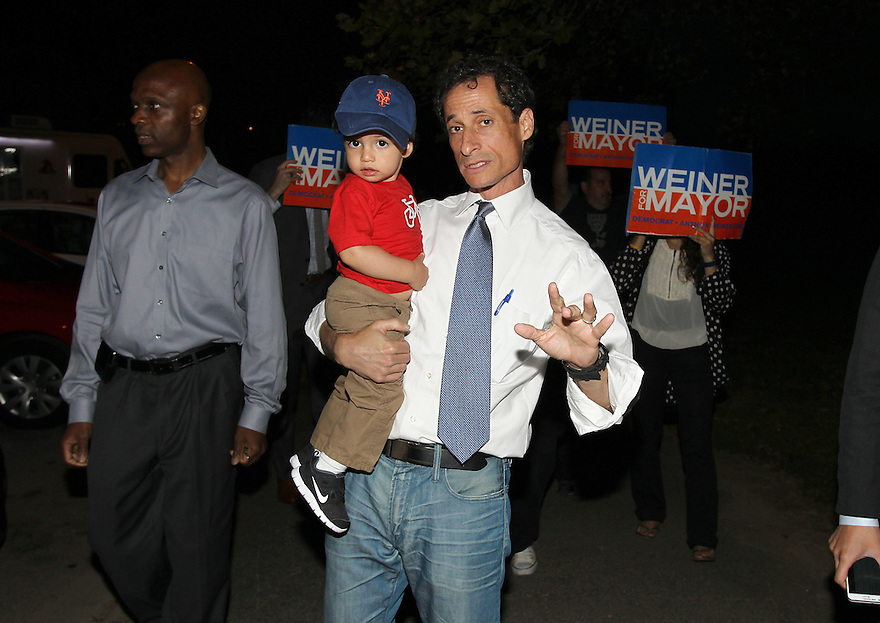 Anthony Weiner along with son Jordan Weiner are seen at Cunningham Park during a campaign stop on Thursday, August 15, 2013 in Queens, New York. (AP Photo/ Donald Traill)