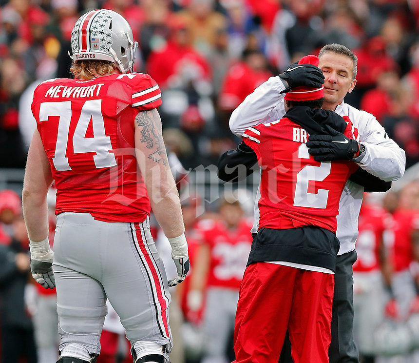 Ohio State Buckeyes head coach Urban Meyer hugs Ohio State Buckeyes safety Christian Bryant (2) during  senior day before the start of their game against Indiana Hoosiers at Ohio Stadium in Columbus, Ohio on November 23, 2013.  (Dispatch photo by Kyle Robertson)