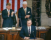 United States President George H.W. Bush speaks to a Joint Session of the U.S. Congress in the U.S. House Chamber in the Capitol in Washington, D.C. to report on the victory over Iraq in the Gulf War on March 6, 1991.  U.S. Vice President Dan Quayle, left, and Speaker of the U.S. House Tom Foley (Democrat of Washington) stand behind the President..Credit: Arnie Sachs / CNP