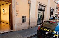 Roma 25 Gennaio 2013.Una auto della Guardia di Finanza  davanti alla sede del Partito Democratico in Largo del Nazareno, e alla sede del Monte dei Paschi di Siena..
