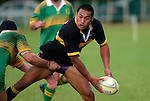 K. Koiatu looks to get the pass away as he is tackled by Drury's R. Shubert.  Counties Manukau Premier Club Rugby, Drury vs Bombay played at the Drury Domain, on the 14th of April 2006. Bombay won 34 - 13.
