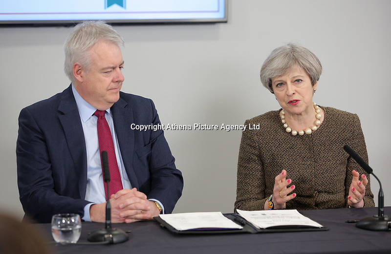 British Prime Minister Theresa May (R) speaks alongside First Minister for Wales Carwyn Jones during the Bay City Region deal, at the Liberty Stadium, Swansea, Wales, UK. Monday 20 March 2017.