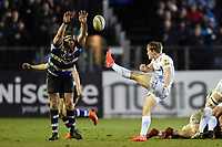 Stuart Townsend of Exeter Chiefs box-kicks the ball as Henry Thomas of Bath Rugby looks to charge him down. Aviva Premiership match, between Bath Rugby and Exeter Chiefs on March 23, 2018 at the Recreation Ground in Bath, England. Photo by: Patrick Khachfe / Onside Images