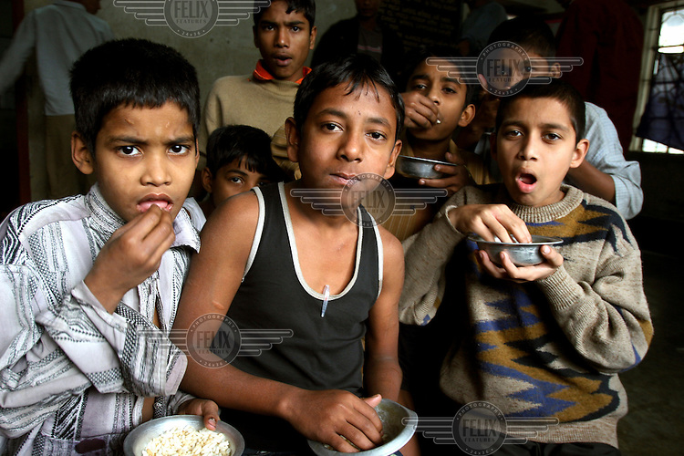Young addicts are given a meal at a drug rehabilitation centre.