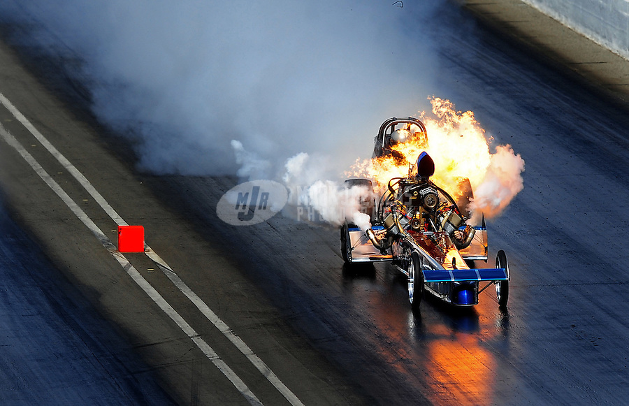 Mar. 7, 2010; Bakersfield, CA, USA; Nostalgia top fuel dragster driver Mike McLennan explodes an engine during the 52nd annual March Meet at the Auto Club Famoso Raceway. Mandatory Credit: Mark J. Rebilas-