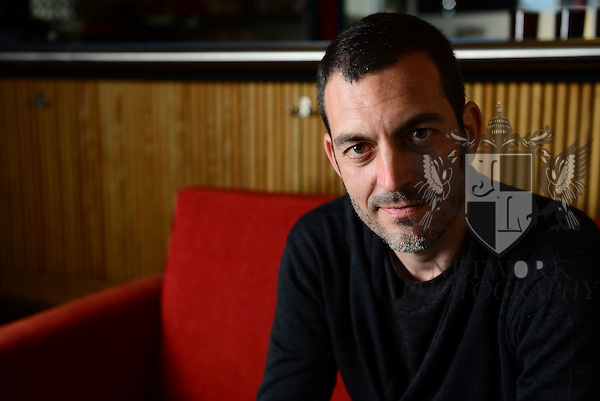 MIAMI BEACH, FL - MARCH 10: (EXCLUSIVE COVERAGE) Director Alfredo Montero poses for a portrait session promoting his new film 'In Darkness We Fall' during the Miami International Film Festival 2014 at The Standard on March 10, 2014 in Miami Beach, Florida. (Photo by Johnny Louis/jlnphotography.com)