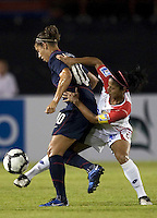 Carli Lloyd of USA (left) battles against Shirley Cruz of Costa Rica (right). USWNT vs Costa Rica in the 2010 CONCACAF Women's World Cup Qualifying tournament held at Estadio Quintana Roo in Cancun, Mexico on November 1st, 2010.
