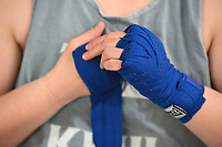 NWA Democrat-Gazette/J.T. WAMPLER A student wraps her hands before a kick-boxing class Wednersday Feb . 21, 2018 at Fayetteville Fitness Kickboxing.