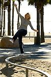 Woman balancing on a rail