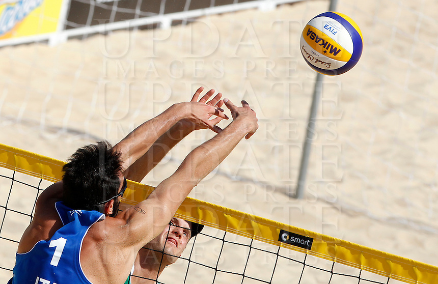 Italy's Paolo Nicolai, left, and Austria's Alexander Huber in action during the match between Italy and Austria at Beach Volleyball World Tour Grand Slam, Foro Italico, Rome, 21 June 2013.<br /> UPDATE IMAGES PRESS/Isabella Bonotto
