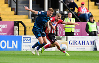 Lincoln City's Harry Anderson vies for possession with Bristol Rovers' Alfie Kilgour<br /> <br /> Photographer Chris Vaughan/CameraSport<br /> <br /> The EFL Sky Bet League One - Lincoln City v Bristol Rovers - Saturday 14th September 2019 - Sincil Bank - Lincoln<br /> <br /> World Copyright © 2019 CameraSport. All rights reserved. 43 Linden Ave. Countesthorpe. Leicester. England. LE8 5PG - Tel: +44 (0) 116 277 4147 - admin@camerasport.com - www.camerasport.com