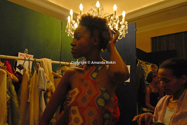 A model in Ethiopian fashions backstage during the Millennium Fashion Gala at the Hilton Hotel in Addis Ababa, Ethiopia on September 4, 2007. An annual event showcasing Ethiopian fashions, the Fashion Gala raises money for a girls school near Addis Ababa, Ethiopia.