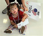 Blaine, Minnesota: September 19, 2008.Elly Snow, 3, holds a sign conveying an affectionate sentiment for Tirg Palin, the baby of Republican vice presidential candidate Sarah Palin. Snow was given the sign by her grandmother at the conclusion of a campaign rally attended by Sarah Palin held inside an aircraft hanger at Anoka County Blaine Airport (where this photo was taken). Snow and Trig Palin are afflicted with Down syndrome.  ©Christopher Fitzgerald / CandidatePhotos.com.