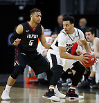 SIOUX FALLS, SD: MARCH 6: Daniel Norl #13 of Omaha shields the ball from Kellon Thomas #5 of IUPUI during the Summit League Basketball Championship on March 6, 2017 at the Denny Sanford Premier Center in Sioux Falls, SD. (Photo by Dick Carlson/Inertia)