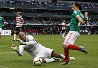MEXICO CITY, MEXICO - AUGUST 15, 2012:  Tim Howard (1) of the USA MNT dives at the feet of Andres Guardado (18) of  Mexico during an international friendly match at Azteca Stadium, in Mexico City, Mexico on August 15. USA won 1-0.