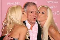 18 August 2006 - West Hollywood, California - Holly Madison, Hugh Hefner, and Kendra Wilkinson.  Paris Hilton's CD Release Party - Arrivals held at Privilege.  Photo Credit: Zach Lipp/AdMedia (Newscom TagID: admphotos102943.jpg) [Photo via Newscom]