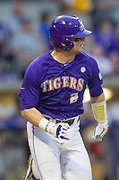 LSU Tigers catcher Tyler Moore #2 runs to first base during the Southeastern Conference baseball game against the Georgia Bulldogs on March 22, 2014 at Alex Box Stadium in Baton Rouge, La. The Tigers defeated the Bulldogs 2-1. (Andrew Woolley/Four Seam Images)