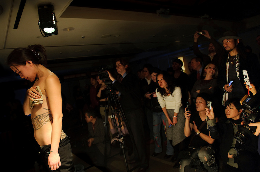 """A model displaying a tattoo by Horimyo. Tattoo demonstration, FCCJ, 25 Feb 2009. Author Manami Okazaki and photographer Martin Hladik introduce their book: """"Tattoo in Japan"""" while tattoo master Horimyo gives a demonstration of his art."""