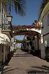 The narrow paths between houses and apartments in Mogan, designed on Venice style. Gran, Canaria,Canary Islands, Spain.