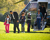 Washington, D.C. - November 8, 2009 -- United States President Barack Obama and his family return from Camp David aboard Marine 1 on Sunday, November 8, 2009.  From left to right: Sasha Obama, President Obama, Malia Obama, unidentified Marine Guard (saluting), first lady Michelle Obama, Marion Robinson..Credit: Ron Sachs / CNP.(RESTRICTION: NO New York or New Jersey Newspapers or newspapers within a 75 mile radius of New York City)