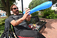 NWA Democrat-Gazette/FLIP PUTTHOFF <br /> MONKEYING AROUND<br /> Anthony &quot;The Bentonville Balloon Man&quot; Kellington forms a sword out of a balloon on Friday Sept. 7 2018 during the First Friday event in downtown Bentonville. The downtown area becomes a community block party with a different theme on the first Friday of each month. Kellington has made balloon art at First Friday for two years. There's no charge for his creations but recipients may leave a tip.