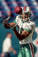 MIAMI, FL - DEC 19, 1999:  Oronde Gadsden, #86, catches a pass as the Miami Dolphins defeat the San Diego Chargers 12-9 at Joe Robbie Stadium, in Miami, FL. (Photo by Brian Cleary/www.bcpix.com)
