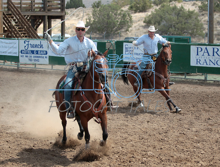 Brian Hansen and Tod Radelfinger compete in the double mugging event at the Minden Ranch Rodeo in Gardnerville, Nev., on Sunday, July 22, 2012..Photo by Cathleen Allison