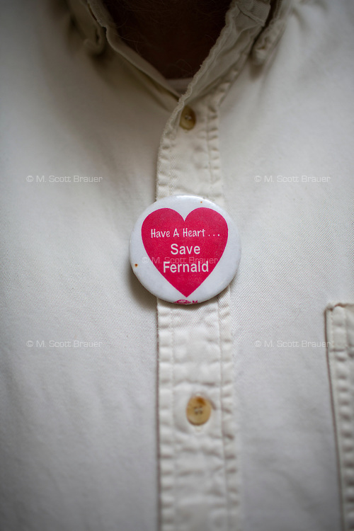 "The Fernald Developmental Center vocational instructor wears a pin that reads ""Have a Heart / Save Fernald,"" in Waltham, Mass., USA. The pins were made by the Fernald League, which started in 2001 as a response to efforts to close Fernald."