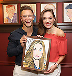 Nathan Johnson and Laura Osnes with her portrait  during the Corey Cott Sardi's Portrait unveiling at Sardi's Restaurant on August 11, 2017 in New York City.