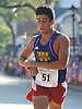 Alex Saavedra of Holtsville (Bib No. 51) eyes the finish line of Northport's annual Cow Harbor 10-kilometer run on Saturday, September 19, 2015. He was the second Long Islander to complete the race and finished in the top 10 (9th overall) with a time of 31:19.80.<br /> <br /> James Escher