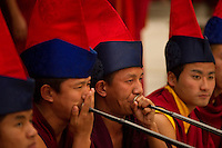 Buddhist lamas playing unique pipes in a Losar ceremony, Sikkim, India