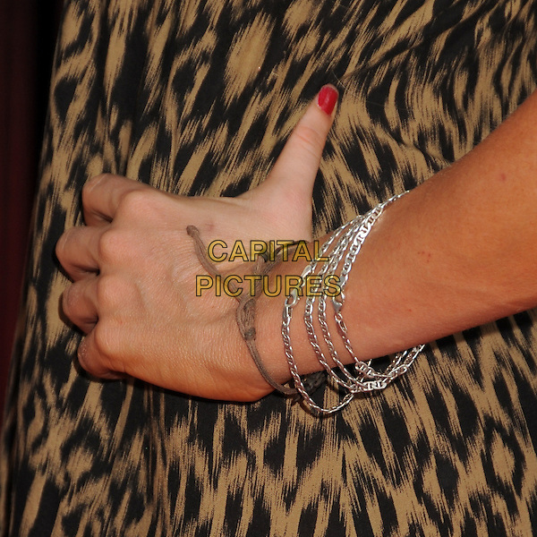 "Sophie Monk's hand.""Real Steel"" Los Angeles Premiere Held at A Universal City Walk Cinemas, Hollywood, California, USA..October 2nd, 2011.on hip silver bracelets black brown leopard print  .CAP/ADM/KB.©Kevan Brooks/AdMedia/Capital Pictures...CAP/ADM/BP.©Byron Purvis/AdMedia/Capital Pictures."