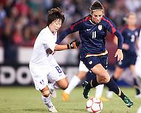 Carli Lloyd (11) of USA gets past Kwon Han Nul (8) of South Korea during an international friendly match at City Stadium on November 1, 2008 in Richmond, Virginia. USA won 3-1.