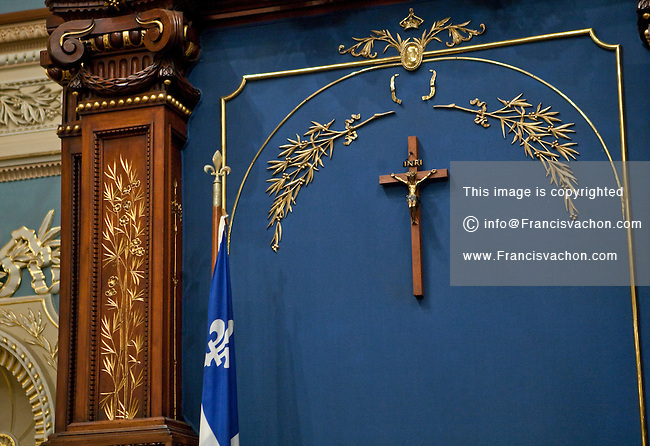 A crucifix is seen above the Speaker's chair at the national Assembly (Assemblee Nationale) in Quebec city Wednesday March 9, 2011.
