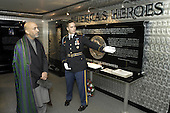 Washington, DC - June 14, 2004 -- Specialist Kevin Smith, United States Army, explains the Pentagon memorial to President Hamid Karzai of Afghanistan during a tour of the Pentagon in Washington, D.C. on June 14, 2004.  The memorial is dedicated to the 184 persons killed in the terrorists' attack of Sept. 11, 2001.  Karzai toured the memorial and the adjacent chapel with Secretary of Defense Donald H. Rumsfeld following their security discussions on June 14, 2004.  Smith is a native of Oakland, California..Credit: Robert D. Ward / DoD via CNP