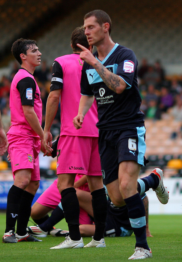 Burnley's Chris McCann  celebrates scoring his sides first goal ..Football - Football - Capital One Cup First Round - Port Vale v Burnley - Tuesday 14th August 2012 - Vale Park - Burslem. .