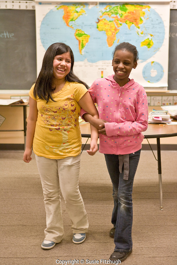 Elementary school students perform their own work in Amber Flame's afterschool Spoken Word class.