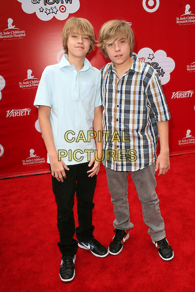 COLE SPROUSE & DYLAN SPROUSE .Target Presents Variety's Power of Youth held at LA Live, Los Angeles, California.04 October 2008. .full length twins brothers family siblings brown plaid shirt black jeans trousers trainers .CAP/ADM/KB.©Kevan Brooks/Admedia/Capital PIctures