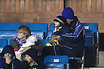 Manuel Pascali sits disconsolately in the family section cuddling his little boy after being sent off early in the game