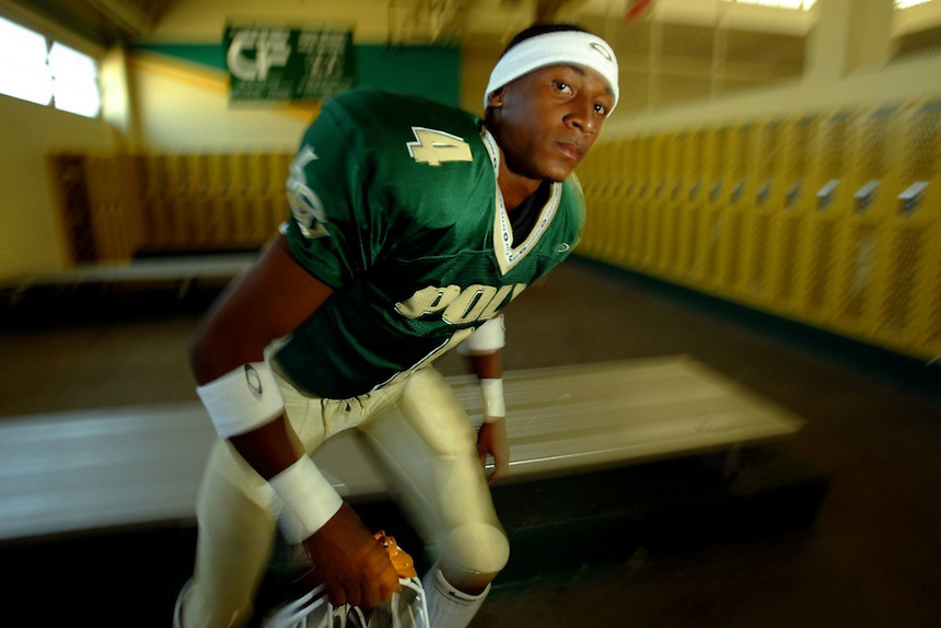 Long Beach--Long Beach Poly wide receiver Derrick Jones is the top returning wide receiver in the county. He is also one of the fastest sprinters in the state. Here, he is photographed in the locker room. Derrick Jones heads into a new season.