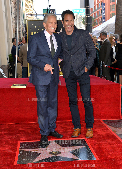 LOS ANGELES, CA. November 06, 2018: Michael Douglas &amp; Eric McCormack at the Hollywood Walk of Fame Star Ceremony honoring actor Michael Douglas.<br /> Pictures: Paul Smith/Featureflash