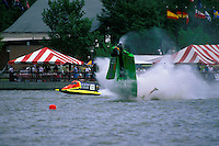 Frame 10: Halfway around the first lap, Wyatt Nelson (#39) blows the boat over crashing back to the water. Nelson was unhurt in the crash. (SST-120 class) Bay City, MI 1998