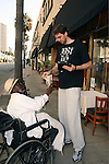 .May 31st 2012.. L.A Laker Pau Gasol helps out a homeless man & signed an autograph for him in Beverly Hills...AbilityFilms@yahoo.com.805 427 3519.www.AbilityFilms.com