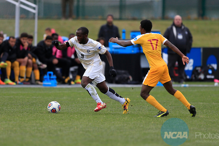 KANSAS CITY, MO - DECEMBER 03:  Tam Dimairo (17) of the University of Charleston and Elma N'for (9) of Wingate University battle for the ball during the Division II Men's Soccer Championship held at Children's Mercy Victory Field at Swope Soccer Village on December 03, 2016 in Kansas City, Missouri. Wingate beat Charleston 2-0 to win the National Championship. (Photo by Jack Dempsey/NCAA Photos via Getty Images)