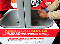 BOGOTA, COLOMBIA - March 13:  People wash their hands on a sink with information about coronavirus on March 13, 2020 in Bogota, Colombia. The World Health Organization declared a global pandemic as the coronavirus rapidly spreads across the world. Colombian President Ivan Duque declared a health emergency to contain an outbreak of coronavirus, suspending public events with more than 500 people. (Photo by John W. Vizcaino/VIEWpress)