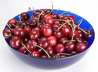 Sweet Cherries on white backdrop.