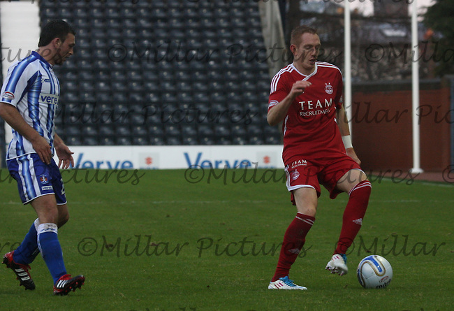 Robert Milsom on the ball being watched by Gary Fisher in the Kilmarnock v Aberdeen Clydesdale Bank Scottish Premier League match played at Rugby Park, Kilmarnock on 3.12.11