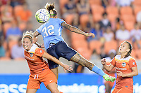 Houston, TX - Friday April 29, 2016: Tasha Kai (32) of Sky Blue FC wins a header over Ellie Brush (8) of the Houston Dash at BBVA Compass Stadium. The Houston Dash tied Sky Blue FC 0-0.