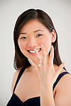 Young Asian woman showing off engagement ring