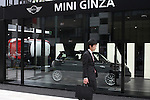 May 14, 2010 - Tokyo, Japan - A man walks past the MINI Ginza, the MINI's 100th showroom in Japan, on May 14, 2010. Opened on May 12 in Tokyo, this showroom will be a center for new MINI products and lifestyle events, with regular events and activities according to the car maker.